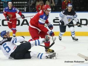 IIHF World Championship 2014  Atte Ohtamaa #5, Alexander Ovechkin #8 , Tommi Kivistö #6