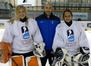 Former NHL and Austrian national goalie Reinhard Divis gives something back to girls (left Inka Kuusinen from Finland, right Maria Meza from Mexico) at the 2014 IIHF Hockey Development Camp in Vierumäki, and learns for building a goalie coach program at home.