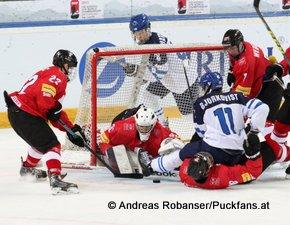 IIHF U18 World Championship 2015 1/2 Final FIN - SUI Sandro Forrer #22, Joren van Pottelberghe #30, Calvin Thürkauf #18, Kasper Björkqvist #11, Serge Weber #7 © Andreas Robanser/Puckfans.at