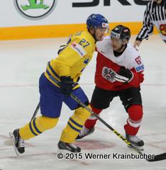 IIHF World Championship 2015 Preliminary Round AUT - SWE Jimmie ERICSSON (SWE); Konstantin KOMAREK (AUT) ⒸWerner Krainbucher/Puckfans.at