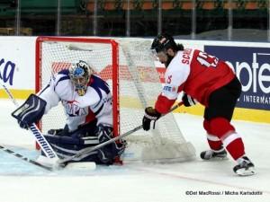 2016 IIHF World Championship Division 1 AUT - KOR Matt Dalton #30, Michael Schiechl #13 ©Det MacRossi / Micha Karlsdottir