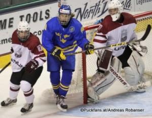 2016 IIHF U18 World Championship LAT - SWE Ralph Engelstad Arena, Grand Forks Deniss Smirnovs #10, Axel Jonsson Fjällby #16, Mareks Egils Mitens #30 ©Puckfans.at/Andreas Robanser