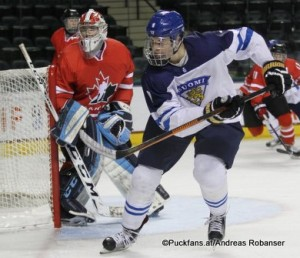 2016 IIHF U18 World Championship FIN - CAN Ralph Engelstad Arena, Grand Forks Evan Fitzpatrick #1, Jesse PuljuJarvi #9 ©hockeyfans.ch/Andreas Robanser