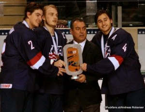 2016 IIHF U18 World Championship Bronze Medal Game USA - CAN Ralph Engelstad Arena, Grand Forks Luke Martin #2, Ryan Lindgren #18, Frank Gonzales IIHF, Chad Krys #4 ©Puckfans.at/Andreas Robanser