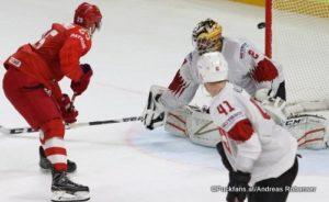 IIHF World Championship  RUS - SUI Joël Vermin #83, Mikhail Grigorenko  #25, Mirco Müller  #41, Reto Berra #20 Royal Arena, Copenhagen ©Puckfans.at/Andreas Robanser