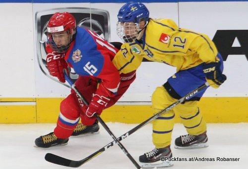 Hlinka Gretzky Cup 2018, Semifinal SWE - RUS Daniil Gushchin #15, Arvid Costmar #12 Rogers Place, Edmonton ©Puckfans.at/Andreas Robanser