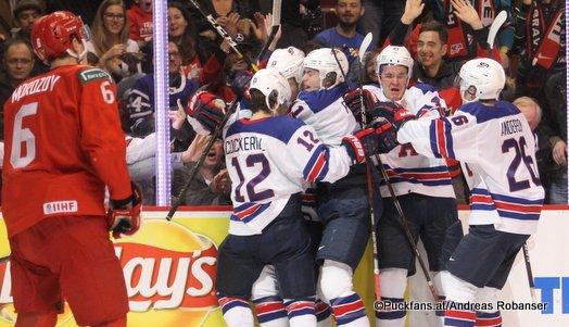 IIHF World Juniors Semifinal RUS - USA Ilya Morozov #6, Logan Cockerill #12, Dylan Samberg #4, Michael Anderson #26 Rogers Arena, Vancouver ©Puckfans.at/Andreas Robanser